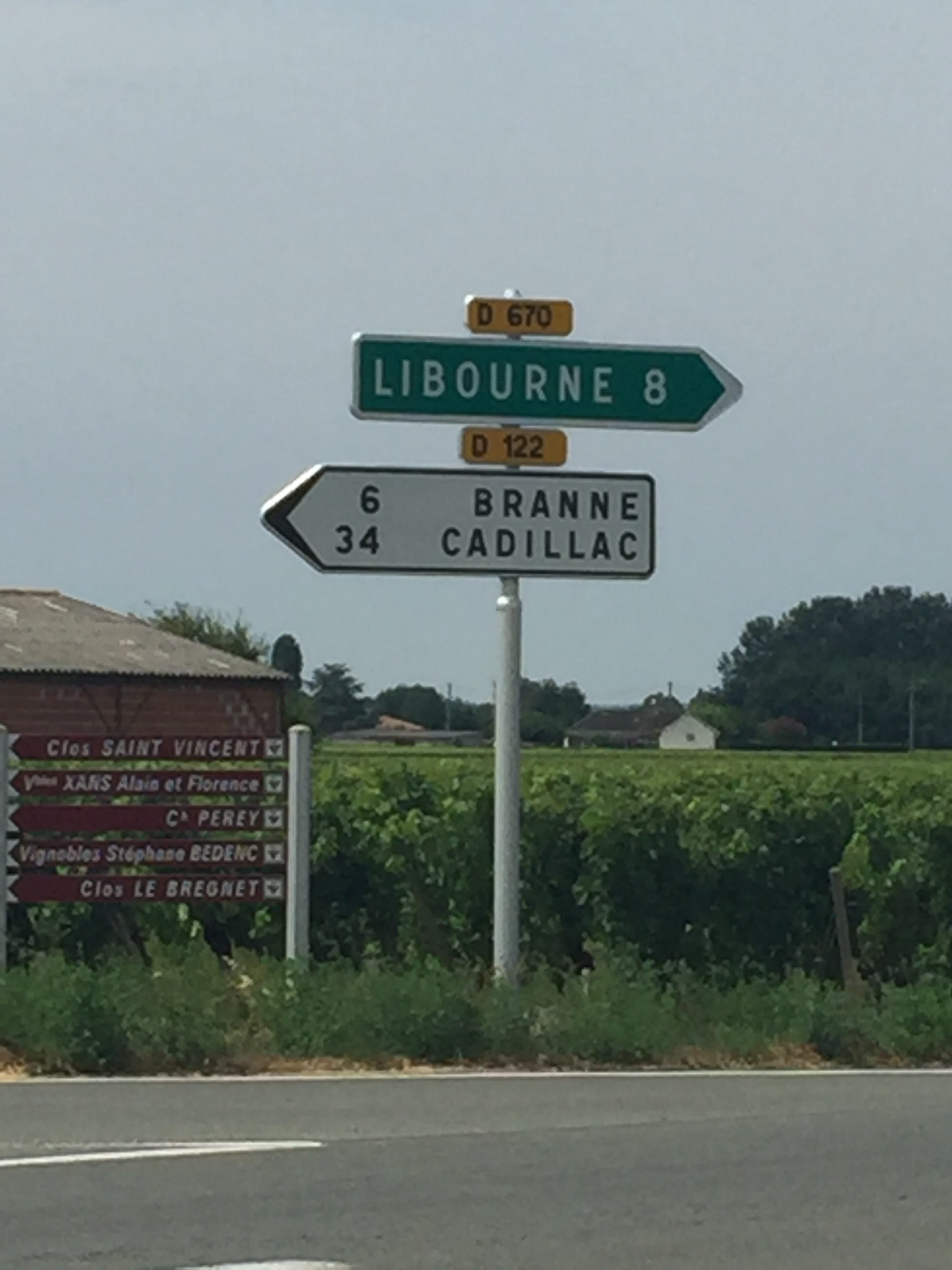 Road sign in France listing town of Cadillac