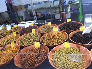 Olives of many local flavors at street market in Pezenas, France
